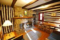 CCC built cabins at Douthat State Park cabin 8 living room furniture furnishing fireplace, (40191931142).jpg