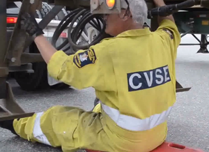 British Columbia Commercial Vehicle Safety and Enforcement - CVSE Officer performing a CVSA Level 1 Inspection