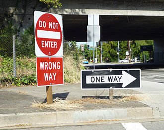Head-on collision - Standard wrong-way sign package used on all freeway off-ramps in the state of California to prevent head-on collisions.