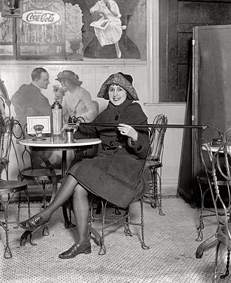 "Walking stick - An unidentified woman holding a ""tippling cane"" or ""cane flask"" in Washington, DC., 1922."
