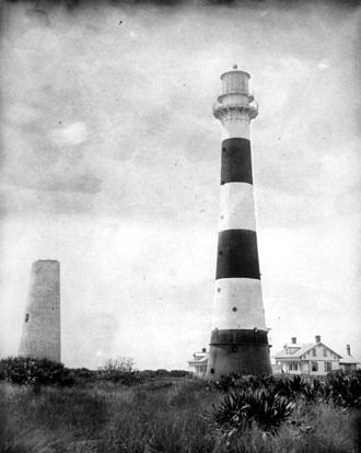 Cape Canaveral Light - The old 1848 brick tower next to the 1868 iron tower with a white lantern room, before the latter was moved in 1893