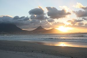 Milnerton - View from Milnerton beach towards Cape Town, showing Table Mountain, Lion's Head and Signal Hill.