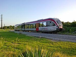 Capital MetroRail - Capital MetroRail Red Line approaching Lakeline Station.