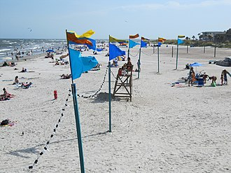 The Last Song (film) - Remnants of the carnival set, such as these flags and light strings, were re-established to create the illusion that the beach scenes filmed in late July had taken place during the festival filmed in June.