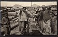 Carrying a Beam, probably at the sawmill in Korea (1914 by Elstner Hilton).jpg