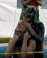 Catwoman choking Wonder Woman (mud wrestling).jpg