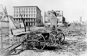 Charleston in the American Civil War - The ruins of Mills House and nearby buildings.  A shell-damaged carriage and the remains of a brick chimney are in the foreground, 1865