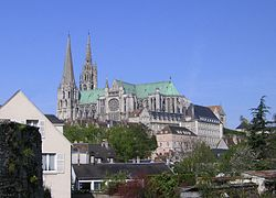 Chartres roofline and profile rises over the modern town.