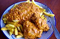 Chicken moambe with French fries (14792587921).jpg