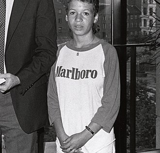 Nicotine marketing - A girl wearing a Marlboro shirt in the 1980s. Owning and being willing to use promotional items is a significant risk factor for nicotine addiction.
