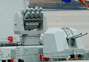 HQ-7 - An eight unit naval HQ-7 launcher behind a Dual barrel Type 79A 100 mm gun.
