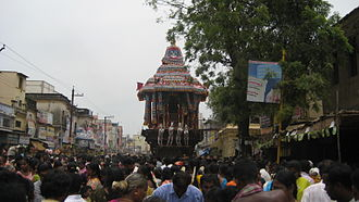 Chithirai festival - Devotees gathered at East Masi street to watch the car setting off, marking the beginning of the car festival.