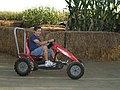 Christopher Riding a Pedal Cart.jpg