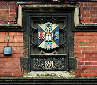 Royal University of Ireland - The arms of the Royal University of Ireland on the southern side of the quadrangle at Queen's University Belfast