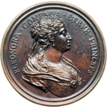 Coin on which Eleonora Luisa Gonzaga, Duchess of Rovere and Montefeltro (wife of Francesco Maria de' Medici) is displayed from circa 1710.png