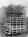 Construction of the William Rust building showing wooden structural supports up to the eight floor and workers laying supports (WASTATE 3384).jpeg