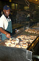 Contract worker prepares fried chicken at Guantanamo.jpg