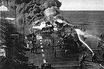 Crewmen fighting fires aboard USS Belleau Wood (CVL-24), on 30 October 1944.jpg