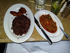 Moros y Cristianos (food) - A Cuban dinner: Arroz Moros with maduros on the left, and ropa vieja on the right