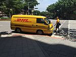 DHL Carrier Back to Mitsubishi Delica at Section 5, Minsheng East Road, Taipei 20160624.jpg