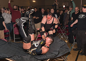 "DJ Hyde - DJ Hyde chokeslamming ""Hacker"" Scotty O'Shea through a table at a Smash Wrestling event in Etobicoke, ON"