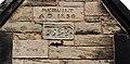 Datestones, porch of St Oswald's, Bidston.jpg