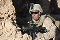 Defense.gov News Photo 120307-M-HR724-098 - A U.S. Marine with Headquarters and Service Company 2nd Battalion 9th Marines provides security during an anti-narcotics operation in Marjah.jpg