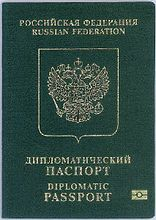 "Cover of Russian Diplomatic e-Passport. Cover is dark green colour with a gold-coloured crest.  Text reads ""RUSSIAN FEDERATION"" and ""DIPLOMATIC PASSPORT"" in Russian and English. Symbol for biometrics is in the lower right corner."