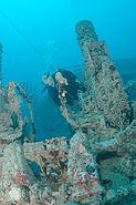 Diver near on old gun mount, Spiegel Grove wreck, Key Largo, Florida