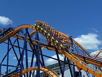 Dominator (roller coaster) - A train dropping from the mid-course brake run