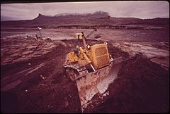 Dragline Scoops Up Debris at Log Boom Site near Northeast Tip of Lake Powell Following Massive Oil Spill Into the San Juan River Spill Originated from Burst Pipeline 200 Miles Upstream, 10-1972 (3814971992).jpg
