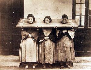 Criminology - Three women in the pillory, China, 1875