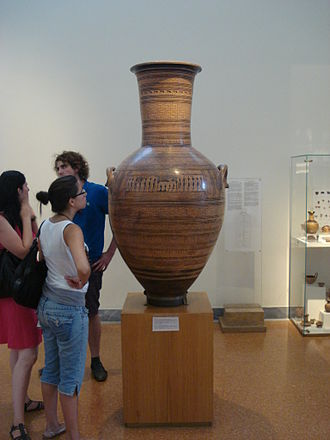 Dipylon Master - The Dipylon Amphora, mid-8th century BC, with human figures for scale. The vase was used as a grave marker. National Archaeological Museum, Athens.