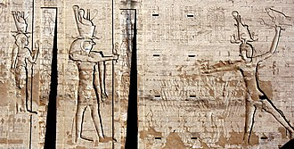 Ptolemy XII Auletes - Egyptian-style statue of Ptolemy XII found at the Temple of the Crocodile in Fayoum, Egypt (left); Relief of Ptolemy XII from the Temple of Kom Ombo (center); First pylon at Edfu Temple, which Ptolemy XII decorated with figures of himself smiting the enemy (right)