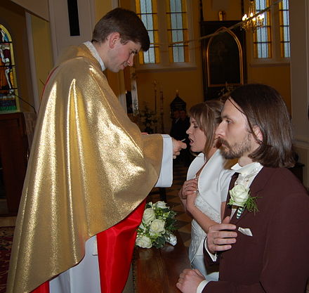 Holy Communion at a Nuptial Mass Ejdzej and Iric wedding communion-01.jpg