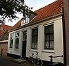 foto van Laag dwarshuis met dakkapel