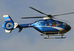 Blue-and-gray police helicopter