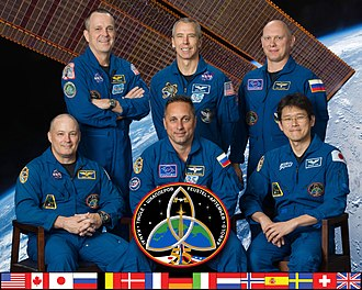 The 55th expedition to the International Space Station in February 2018 Expedition 55 crew portrait.jpg