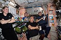 Expedition 64 crew members relax after a meal inside the Unity module.jpg