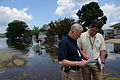 FEMA - 37186 - FEMA workers go over a list while standing in a flooded neighborhood.jpg