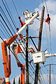 FEMA - 39210 - Utility crew replaces a pole in Texas.jpg