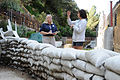 FEMA - 43379 - FEMA worker and resident in California with sand bags.jpg