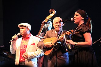 Buena Vista Social Club - Carlos Calunga, Barbarito Torres and Idania Valdés performing with Orquesta Buena Vista Social Club in 2012