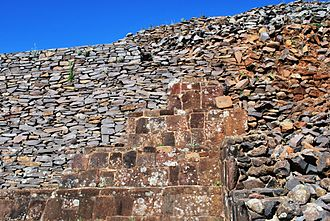 Tzintzuntzan (Mesoamerican site) - Part of one reconstructed yácata showing some of the stone facing.