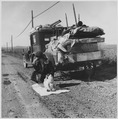 "Farm Security Administration, farmers whose topsoil blew away joined the sod caravans of ""Okies"" on Route 66 to... - NARA - 195532.tif"