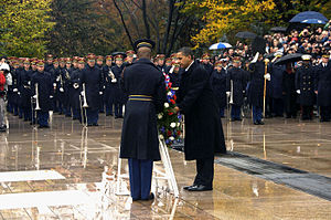 President Barack Obama lays a wreath at the To...