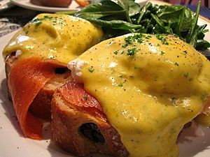Cuisine of the Mid-Atlantic states - Eggs Benedict, a breakfast dish made with poached eggs and hollandaise sauce, served with smoked salmon