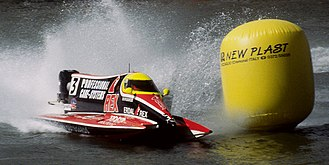 Inshore powerboat racing - An F1 powerboat rounding a buoy