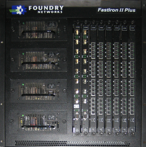 Foundry Networks - Foundry FastIron II Plus chassis with two fiber management cards and six 16-port gigabit Ethernet cards