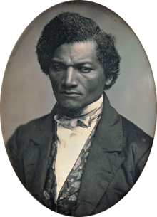Black and white portrait photo of Frederick Douglass